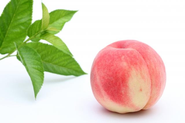 なで桃を撫でて病魔を退治